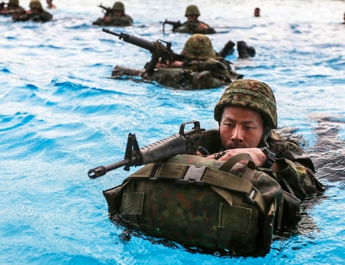 Soldiers assigned to the Japan Ground Self-Defense Force complete Marine Corps swim qualification as part of Exercise Iron Fist 2015 on Camp Pendleton, Calif., Jan. 26, 2015. The annual bilateral training exercise between U.S. and Japanese military forces builds their combined ability to conduct amphibious and land-based contingency operations. U.S. Marine Corps photo by Lance Cpl. Angel Serna