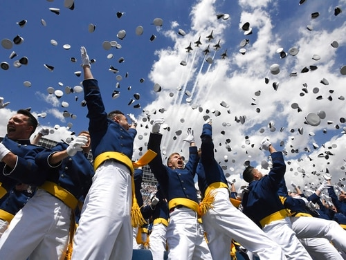 U.S. Air Force Academy cadets toss their hats in the air as the Thunderbirds fly overhead during the cadets' graduation ceremony in Colorado Springs, Colo., in May 2018. President Trump will deliver the commencement address for this year's graduation on May 30. (Jerilee Bennett/The Gazette via AP)