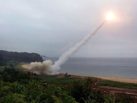 The U.S. Army Tactical Missile System fires a missile into the East Sea during a South Korea-U.S. joint missile drill aimed to counter North Korea's ICBM test on July 29. As tensions remain high between the U.S. and North Korea, a fake message went out on social media instructing Defense Department personnel to evacuate the Korean peninsula. (South Korean Defense Ministry via Getty Images)
