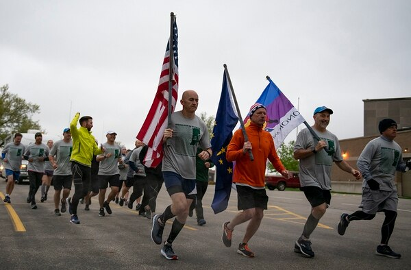 Members of the 122nd Fighter Wing, Indiana Air National Guard support runners during Indiana Run for the Fallen, May 10, 2019, at the Allen County War Memorial Coliseum in Fort Wayne, Ind. (Senior Airman Rita Jimenez/Air National Guard)
