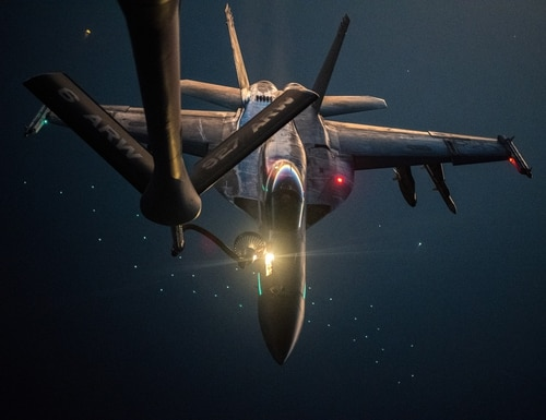 A U.S. Navy F/A-18E Super Hornet is refueled over the U.S. Central Command area of responsibility by a U.S. Air Force KC-135 Stratotanker, Sept. 22, 2020. (Staff Sgt. Jason Allred/Air Force)