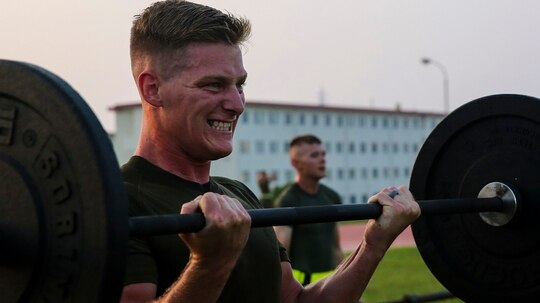 Sgt. Justin D. Boetger curls weights during Force Fitness Instructor course July 31, 2018, at Camp Hansen, Okinawa, Japan. (Pfc. Kindo Go/Marine Corps)
