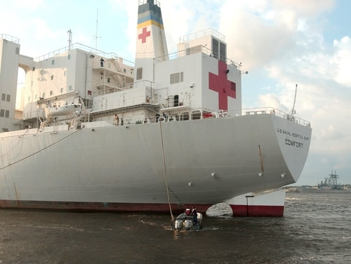 09/05/05 - The Military Sealift Command hospital ship USNS Comfort (T-AH 20) pulls into Naval Station Mayport, Fla., to take on supplies on their way to aid victims of Hurricane Katrina on Sept. 5, 2005. The Navy's involvement in the Hurricane Katrina humanitarian assistance operations is led by the Federal Emergency Management Agency in conjunction with the Department of Defense. (U.S. Navy photo by Photographer's Mate 2nd Class Andrea Decanini) (Released) hkat