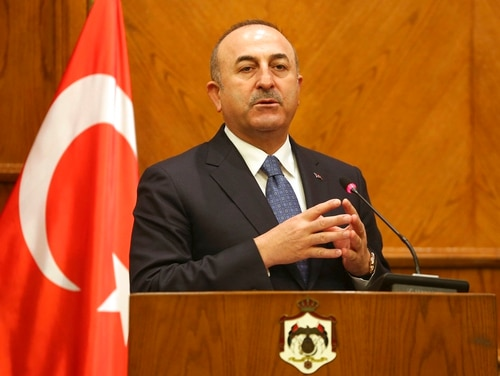 Turkish Foreign Minister Mevlut Cavusoglu, and Jordanian Foreign Minister Ayman Safadi, give a press conference in Amman, Jordan, Monday, Feb. 19, 2018. Cavusoglu said his country is ready to battle Syrian government troops if they enter an enclave in northern Syria to protect Syrian Kurdish fighters. (Raad Adayleh/AP)