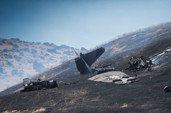 ADDS CONDITION OF PILOTS - The wreckage of a U-2 spy plane that crashed after taking off from Beale Air Force Base on a training mission in Northern California, is seen Tuesday, Sept. 20, 2016. The U.S. Air Force says one pilot was killed, and one was injured after they ejected from the plane. (Hector Amezcua/The Sacramento Bee via AP)