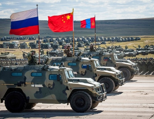 Russian, Chinese and Mongolian troops and military equipment parade at the end of the day of the Vostok-2018 (East-2018) military drills at Tsugol training ground not far from the Chinese and Mongolian border in Siberia on Sept. 13, 2018. (Mladen Antonov/AFP via Getty Images)