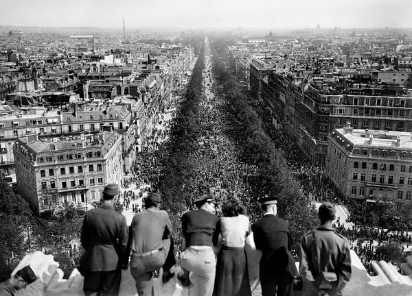 A picture dated of May 8, 1945, shows people looking at the crowded Champs Elysees Avenue from the Triumphal Arch (Arc de Triomphe) as Parisians gathered in the streets to celebrate the unconditionnal German capitulation at the end of the second World War. (AFP/Getty Images)