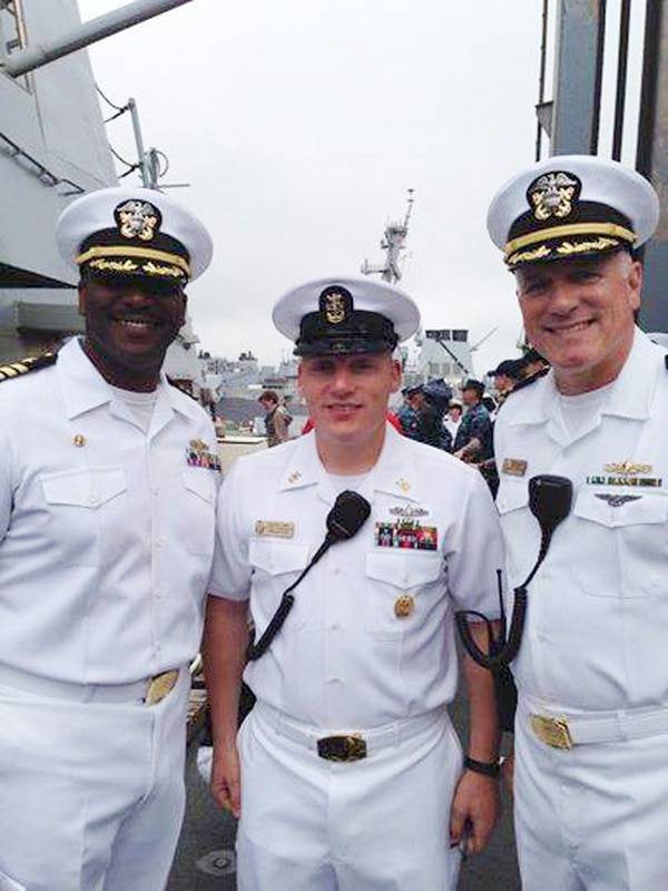 Cmdr. Curtis Calloway, Command Master Chief Travis Biswell and Cmdr. Ed Handley on May 31 aboard the James E. Williams