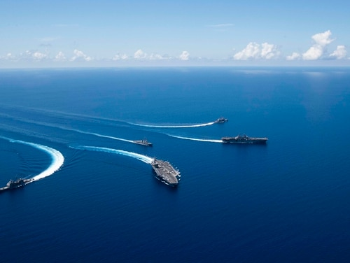 Ships from the Ronald Reagan Carrier Strike Group and the Boxer Amphibious Ready Group conduct breakaway maneuvers while sailing in formation during security and stability operations off Japan on Sunday. (Mass Communication Specialist 2nd Class Erwin Jacob V. Miciano/Navy)