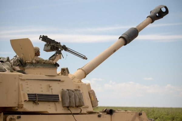 An artilleryman with 4th Battalion, 27th Field Artillery Regiment, 2nd Armored Brigade Combat Team, 1st Armored Division, mans the turret of an M109A6 Paladin howitzer self-propelled gun at Dona Ana Range Complex, New Mexico. (Spc. Matthew J. Marcellus/Army)