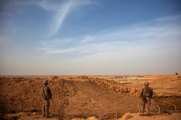 U.S. Marines with Combined Anti-Armor Team, Weapons Company, 1st Battalion, 7th Marine Regiment, patrol inside the perimeter of Al Asad Air Base, Iraq, Oct. 23, 2015. The unit is the ground combat element of Special Purpose Marine Air-Ground Task Force--Crisis Response--Central Command 16.1, which is in support of Combined Joint Task Force-Operation Inherent Resolve (CJTF-OIR). CJTF-OIR is a coalition of regional and international nations who have joined together to defeat the Islamic State of Iraq and the Levant and the threat they pose to Iraq, Syria, the region and the wider international community. (U.S. Marine Corps photo by Cpl. Akeel Austin/Released)