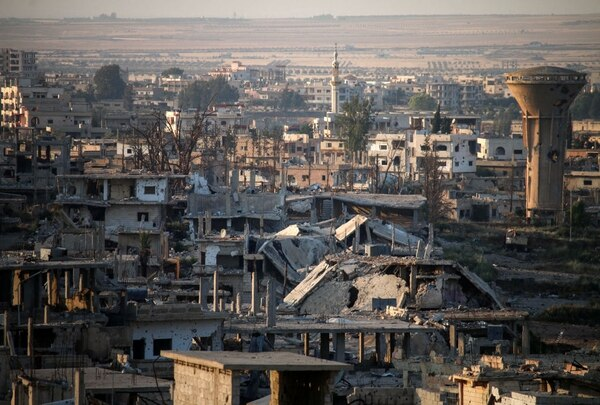 A picture taken on May 30, 2018, shows a general view of destroyed buildings in a rebel-held area in the southern Syrian city of Daraa. (Mohamad Abazeed/AFP via Getty Images)