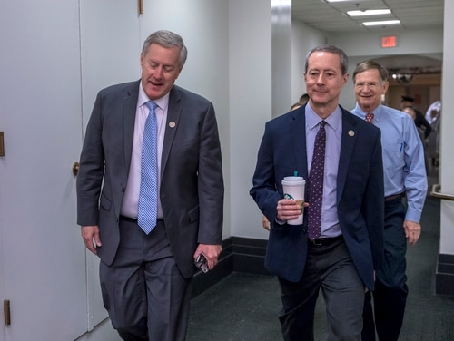 Rep. Mark Meadows, R-N.C., chairman of the conservative Freedom Caucus, left, is joined by House Armed Services Committee Chairman Mac Thornberry, R-Texas, center, and Rep. Lamar Smith, R-Texas. (J. Scott Applewhite/AP)