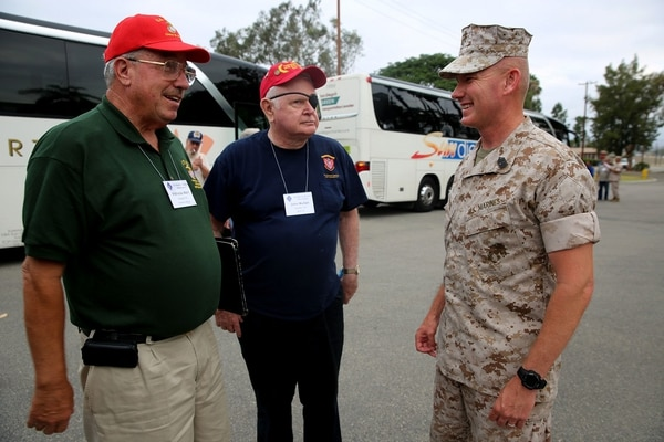 Sergeant Major William T. Sowers, the 1st Marine Division sergeant major, speaks with two Vietnam veterans that are members of the 1st Mar. Div. Association during their 68th annual reunion, aboard Marine Corps base Camp Pendleton, Calif., Aug. 20, 2015. During the reunion, veterans visited their old stomping grounds and reminisced about their days serving in the division, while also observing the capabilities of today's Marines. (U.S. Marine Corps photo by Cpl. Demetrius Morgan/RELEASED)
