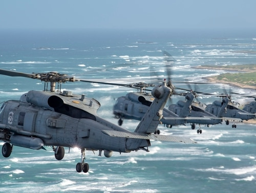 MH-60R Sea Hawk helicopters from the Easyriders of Helicopter Maritime Strike Squadron 37, fly in formation around the Island of Oahu on Nov. 26. An HSM 37 crew assisted the Coast Guard in a medevac mission on New Year's Day. (Mass Communication Specialist Seaman Aja B. Jackson/Navy)