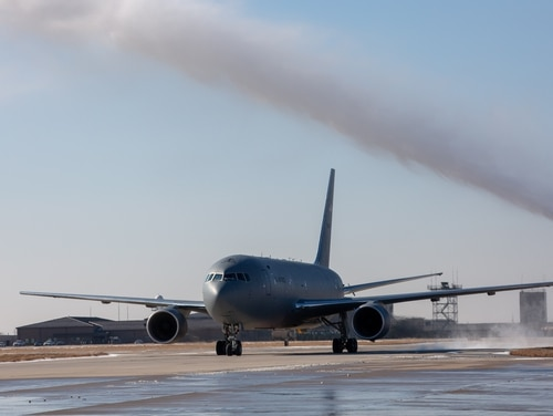 The Air Force's KC-46 taxis under a water cannon bath at McConnell AFB in Kansas. (Jeff Martin/Staff)