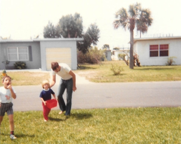 Kristen Emery plays in the front yard of the family's military base housing at Patrick Air Force Base in the early 1980s. (Courtesy of Kristen Emery)