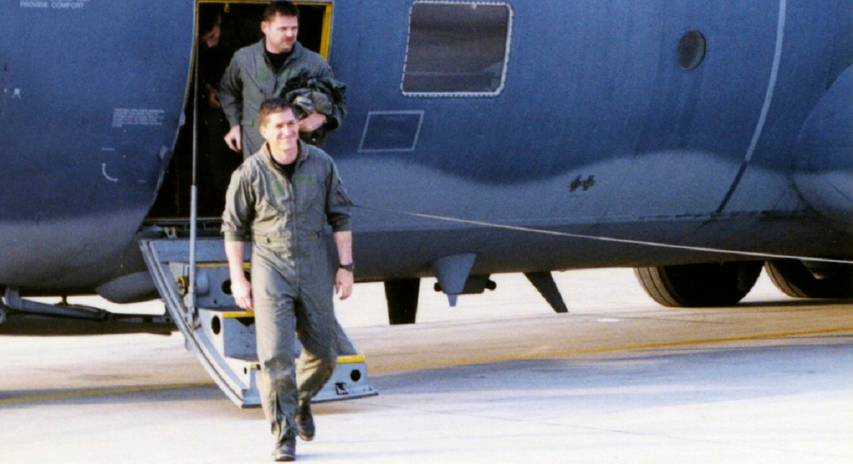 Lt. Col. Dave Goldfein, commander of the 555th Fighter Squadron, emerges on the apron at Aviano Air Base following his rescue in Serbia in May 1999. (Air Force)