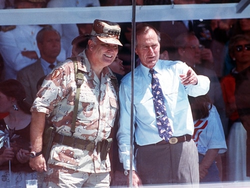 Gen. Norman Schwarzkopf and President George H.W. Bush watch the National Victory Parade in Washington, D.C., on June 8, 1991. Defense leaders honored the former commander in chief on Saturday as America woke up to news of his passing at the age of 94. (Ron Edmonds/AP)