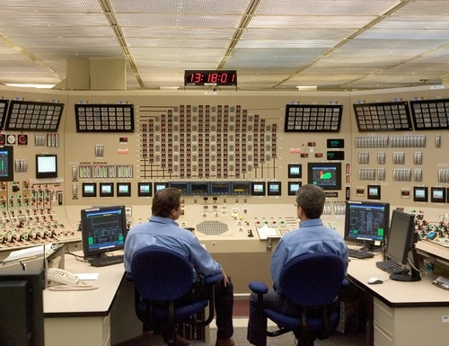 Employees work in the control room at Browns Ferry Nuclear Plant in Athens, Ala., on June 21, 2007. The plant was the largest in the world when it was first opened in 1974 by the Tennessee Valley Authority. (Saul Loeb/AFP via Getty Images)