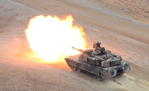 An M1A2 Abrams tank from Company D, 2nd Battalion, 9th Infantry (Mechanized), 1st Armored Brigade Combat Team, 2nd Infantry Division, fires its main gun at a target March 3 at Rodriguez Live Fire Complex. Bradley and M1A2 Abrams tank crews from 2-9th Infantry conducted gunnery skills training March 1-4 to ensure unit readiness. This was the last major exercise before unit's scheduled deactivation. (U.S. Army photo by Cpl. SeeWon Lee, 1ABCT)(Cutlines by Sgt. Samuel Northrup, 1ABCT)