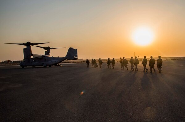 U.S. Marines with 2nd Battalion, 7th Marine Regiment, Special Purpose Marine Air Ground Task Force - Crisis Response - Central Command, prepare to board MV-22B Ospreys from Marine Medium Tiltrotor Squadron 363, SPMAGTF-CR-CC, during a Tactical Recovery of Aircraft and Personnel rehearsal drill in the U.S. Central Command area of operations, Oct. 25, 2014. The Marines and sailors of SPMAGTF-CR-CC serve as an expeditionary, crisis-response force tasked with supporting operations, contingencies and security cooperation in Marine Corps Forces Central Command and CENTCOM. (U.S. Marine Corps photo by Lance Cpl. Skyler E. Treverrow/Released)