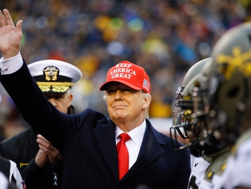 President Donald Trump waves ahead of an NCAA college football game between Army and Navy, Saturday, Dec. 14, 2019, in Philadelphia. (AP Photo/Matt Rourke)
