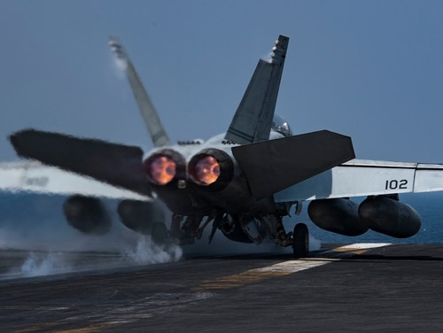 An F/A-18F Super Hornet launches from the flight deck of the aircraft carrier Dwight D. Eisenhower in 2016. The Pentagon announced that the Ike will remain in the Middle East to support the withdrawal of American forces from Afghanistan. (PO3 Nathan T. Beard/Navy)