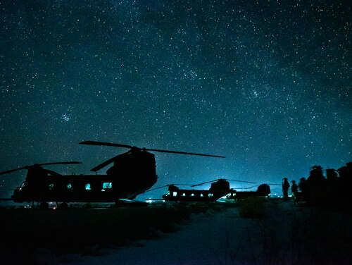 U.S. special operators line up in chalks near their Chinook helicopters in March 2019. (Sgt. Jaerett Engeseth/Army)