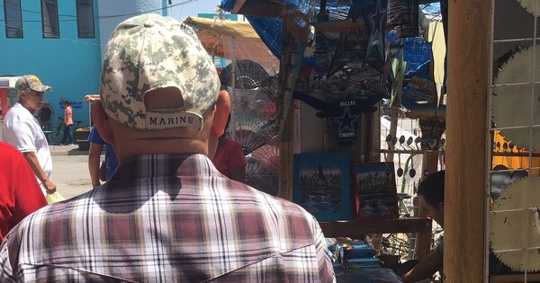 Martinez walks along Progreso's main street, where after sixteen years, he knows many of the vendors who run pharmacies and Mexican crafts shops catering to tourists. (Tara Copp/Military Times)