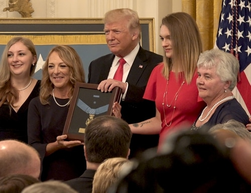 President Donald Trump presents the Medal of Honor posthumously to Air Force Combat controller Tech. Sgt. John Chapman. Accepting the medal were Chapman's wife Valerie Nessel, his two daughters Brianna and Madison, and his mother, Terry Chapman, during a ceremony at the White House on Aug. 22, 2018. (Alan Lessig/Staff)