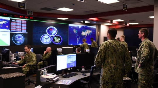 Sailors stand watch in the Fleet Operations Center at the headquarters of U.S. Fleet Cyber Command/U.S. 10th Fleet (FCC/C10F). Since its establishment, FCC/C10F has grown into an operational force composed of more than 14,000 Active and Reserve Sailors and civilians organized into 28 active commands, 40 Cyber Mission Force units, and 26 reserve commands around the globe. (Mass Communications Specialist 1st Class Samuel Souvannason/Navy)
