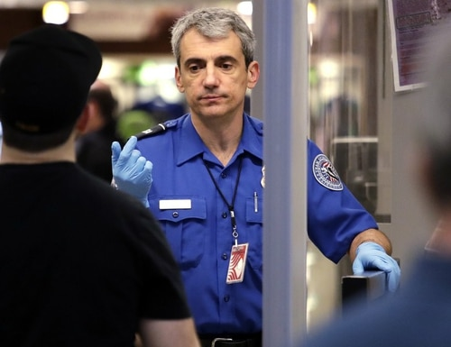 Transportation security officers are now allowed to wear N95 masks. (Elaine Thompson/AP)