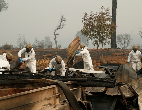 Members of the California Army National Guard search a property for human remains at a home burned in the Camp fire, Wednesday, Nov. 14, 2018, in Paradise, Calif. (John Locher/AP)