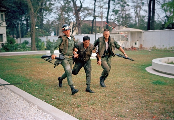 Two U.S. military policemen aid a wounded fellow MP during fighting in the U.S. Embassy compound in Saigon, Jan. 31, 1968, at the beginning of the Tet Offensive. A Viet Cong suicide squad seized control of part of the compound and held it for about six hours before they were killed or captured. (AP Photo)