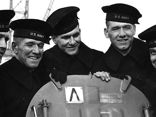 The five brothers on board the light cruiser Juneau (left), Joseph, Francis, Albert, Madison and George Sullivan. The Sullivan brothers were five siblings who all died during the same attack in World War II during the Battle of Guadalcanal, November 1942. (U.S. Naval History and Heritage Command)