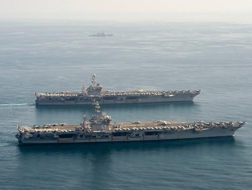 The U.S. Navy aircraft carriers Dwight D. Eisenhower and Harry S. Truman navigate the Arabian Sea. (Seaman Maxwell Higgins/U.S. Navy)