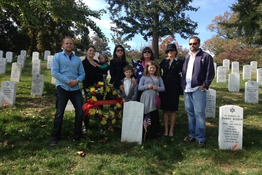 Nancy Menagh, president of Gold Star Wives of America (back, third from right) poses with her children and grandchildren at the grave of her husband, Capt. Philip Menagh, who was killed in a military training exercise in 1984. (Photo courtesy of Nancy Menagh)