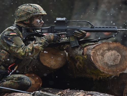 A soldier with mountain infantry brigade 23 of the German Bundeswehr takes part in an exercise near the Bavarian village Bad Reichenhall in March 2016. (Christoff Stache/Getty Images)