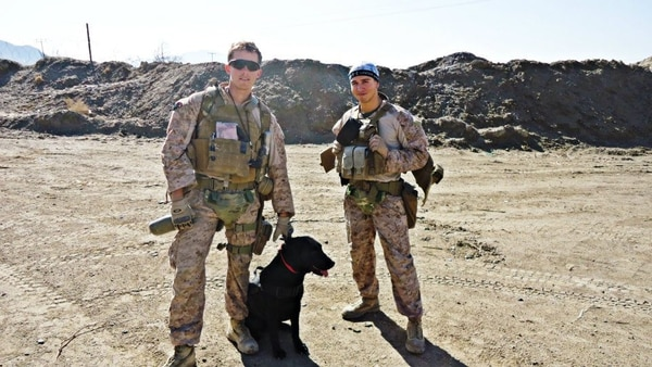Ben McInnis, left, pictured in 2012 before a foot patrol with his IED detection dog, AACE, and fellow Marine, Duff Law, in Afghanistan's Helmand province. McInnis graduated with an information security and assurance degree from Kennesaw State University in 2017 and said the leadership skills he learned in the Marines have helped him in his new job with global technology company Cisco Systems. (Provided by Ben McInnis)