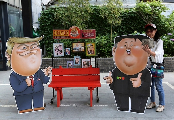 Caricatures depicting U.S. President Donald Trump, left, and North Korean leader Kim Jong Un are displayed in Seoul, South Korea, Sunday, May 26, 2019. In an apparent contradiction of his national security adviser, President Donald Trump on Sunday downplayed recent North Korean missile tests, tweeting from Tokyo that they're not a concern for him in comments sure to unnerve Japanese leaders. (Ahn Young-joon/AP)