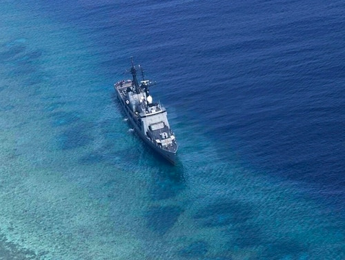 The Philippine Navy ship BRP Gregorio del Pilar is seen after it ran aground during a routine patrol on Wednesday in the vicinity of Half Moon Shoal, which is called Hasa Hasa in the Philippines, off the disputed Spratlys Group of islands in the South China Sea, adding that its crew was unhurt, the military said. Two officials say Friday, Aug. 31, 2018, the Philippines has notified China about a Philippine navy frigate that ran aground in the South China Sea to avoid any misunderstanding because the incident happened near a hotly disputed region. The barren shoal is on the eastern edge of the disputed Spratly archipelago. (Armed Forces of the Philippines via AP)