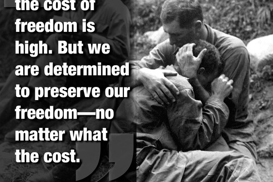 A grief stricken American infantryman whose buddy was killed in action in Korea in 1950 is comforted by another soldier. (Army)
