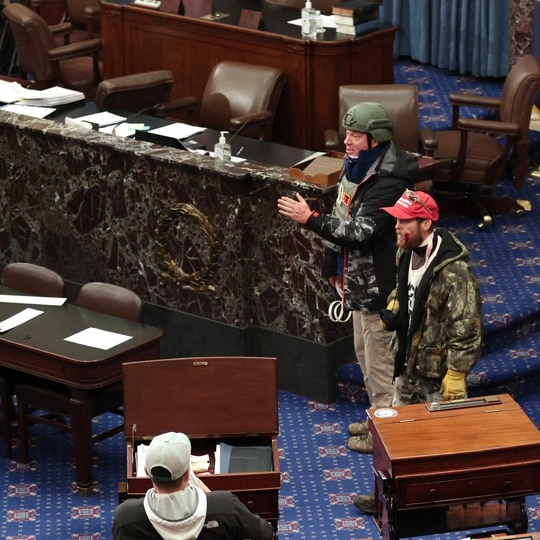 Retired Air Force Lt. Col. Larry Rendall Brock Jr. (in helmet) was photographed on the Senate floor clad in tactical gear and holding flex cuffs. (Win McNamee/Getty Images)