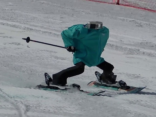 The field of ski robots is small and growing, though it lags far behind the field of remotely controlled stabilized targeting systems. (Photo from RT YouTube screen grab)