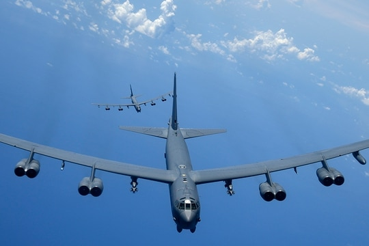 Two B-52H Stratofortress bombers fly over the Pacific Ocean during a routine training mission Aug. 2, 2018. (A1C Gerald R. Willis/U.S. Air Force)