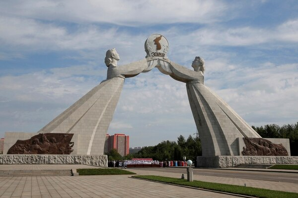 This Tuesday, Sept. 11, 2018, photo shows the Arch of Reunification, a monument to symbolize the hope for eventual reunification of the two Koreas, in Pyongyang, North Korea. While Pyongyang's talks with Washington over the future of Kim Jong Un's nuclear arsenal have bogged down, South Korean President Moon Jae-in is pushing hard to link the roads and railways of the two Koreas and to help improve the North's often decrepit infrastructure. (AP Photo/Kin Cheung)