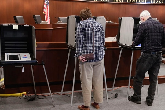States' governors have recently asked the National Guard to help out with election security events. (Michael Conroy/AP)