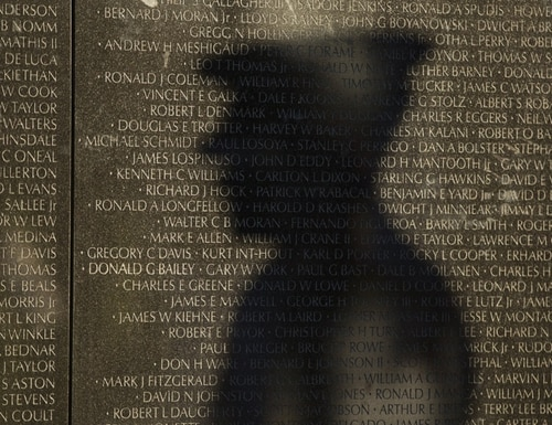 Family members of those whose names appear on the Vietnam Veterans Memorial are among those eligible for a new recognition program commemorating the Vietnam War's 50th anniversary. (Staff/file)