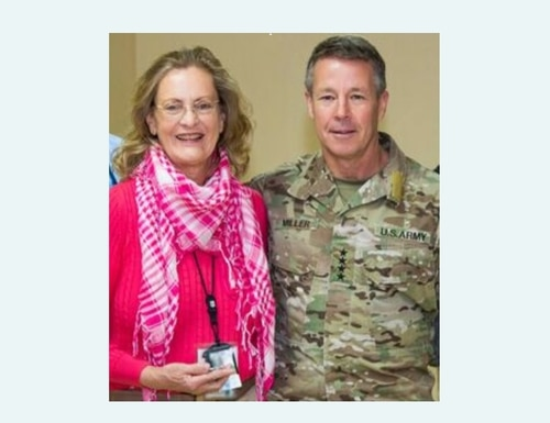 Retired Air Force officer Kathy Lawhon, who deployed to Afghanistan last year as an Air Force civilian, was coined by Army Gen. Scott Miller for her humanitarian efforts during the aftermath of a Taliban attack. (Via Air Force)